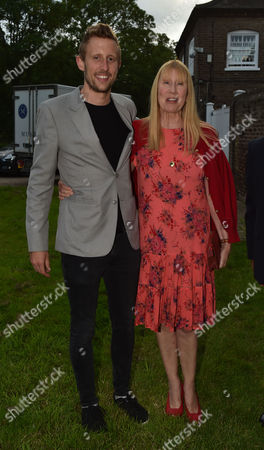 Stock Photo of London UK 21st June 2016: Lady Carina Frost and Her Son George N with His Wife Joyce Reuben at Lady Annabel Goldsmith's Summer Party Ham Gate Richmond Park Twickenham London 21st June 2016