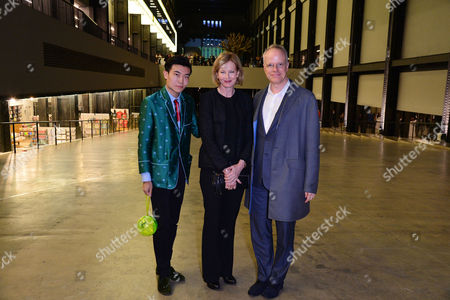 Stock Picture of London, England, 16th June 2016: Michael Xufu Huang, Julia Peyton Jones and Hans Ulrich Obrist Attend the Tate Modern Opening Party , London On the 16th June 2016.