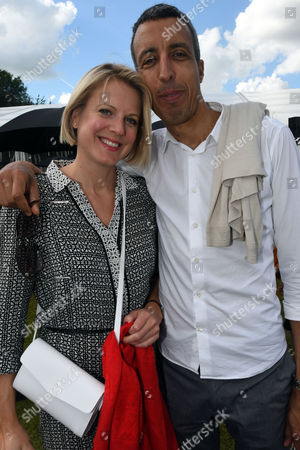 Oxford, England 3rd July 2016 - Kamal Ahmed and His Girlfriend at the Wellbeing of Woman 28th Celebrity Cricket Day in Memory of Miles Frost at Sir Victor and Lady Blanks Home in Chippinghurst Manor Near Oxford, On the 3rd July 2016.