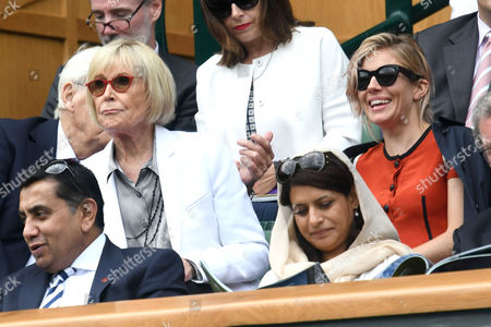 London, England 5th July 2016: Sienna Miller with Sir Michael and Lady Mary Parkinson Seen at Wimbledon On Day 8 of the Championship Held at the All England Lawn Tennis Club On the 5th July 2016.