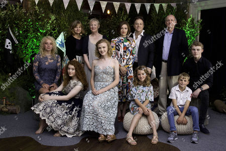 Stock Picture of London, England, 23rd July 2016: Cast and Crew - Seren Hawkes Hannah Jayne Thorp, Producer Andrea Gibb, Director Philippa Lowthorpe, Ora Hill, Kelly Macdonald, Producers Joe Oppenheimer and Nick Barton, Bobby Mcculloch, Teddie Malleson-allen and Dane Hughes Attend the 'swallows and Amazons' Multimedia Vip Screening at Picturehouse Central, London On the 23rd July 2016