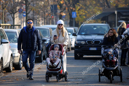 Stock Picture of Michelle Hunziker at Sant'Ambrogio park with her daughter Celeste Trussardi and bodyguard