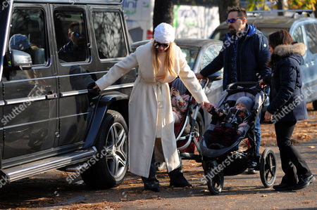 Stock Photo of Michelle Hunziker at Sant'Ambrogio park with her daughter Celeste Trussardi and bodyguard