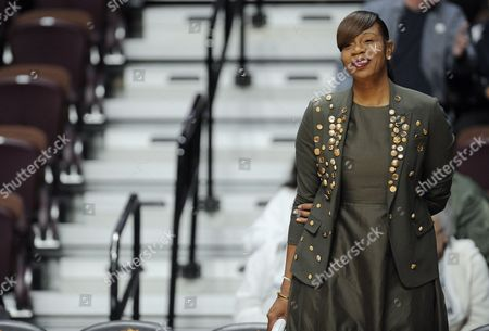 Texas assistant coach Tina Thompson watches warm ups before an NCAA college basketball game, in Uncasville, Conn