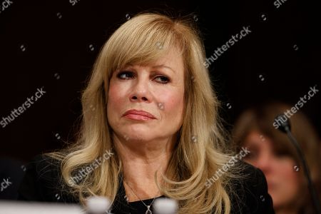 Cinemoi President Daphna Ziman listens on Capitol Hill in Washington, while testifying before a Senate Judiciary subcommittee hearing on the proposed merger between AT&T and Time Warner