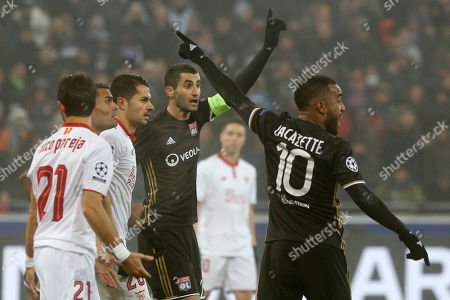 Lyon's Alexandre Lacazette, right, and Lyon's Maxime Gonalons appeal to the referee during the Group H Champions League soccer match between Lyon and Sevilla at the Lyon stadium in Decines, near Lyon, France