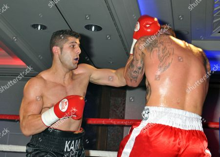 Hasan Karkardi (black shorts) defeats Mitch Mitchell during a Boxing Show at the Royal Lancaster Hotel on 27th October 2014