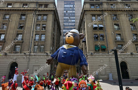 "A balloon depicting the protagonist of the award-winning animated short ""Bear Story"", is used to promote an upcoming Christmas parade organized by a local business, in the Plaza de Armas, in downtown Santiago, Chile, . The film was inspired by the grandfather of director Gabriel Osorio. Osorio's grandfather was exiled from Chile during the military dictatorship of Augusto Pinochet"