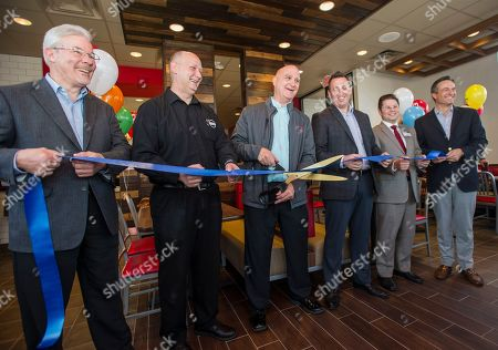 Ron Gallo, George Nadvit, Stuart McDonald, Ken Hannaman, John Rossi, Paul Brown Arby's area supervisor Ron Gallo, with scissors, prepares to officially re-open the newly rebuilt Arby's #1A restaurant along with George Nadvit, left, General Manager Stuart McDonald, Senior Director of Operations Ken Hannaman, President of the local Chamber Foundation, John Rossi, and Arby's CEO Paul Brown, in Boardman, Ohio