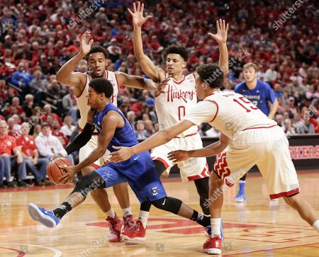 Maurice Watson Jr., Ed Morrow, Tai Webster, Isaiah Roby Creighton's Maurice Watson Jr. (10) drives to the basket between Nebraska's Ed Morrow, far left, Tai Webster (0) and Isaiah Roby (15), during the second half of an NCAA college basketball game in Lincoln, Neb., . Creighton won 77-62