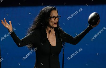 Fito Paez Brazil's actress Sonia Braga speaks during the Fenix Ibero American Film Awards at Esperanza Iris Theater in Mexico City