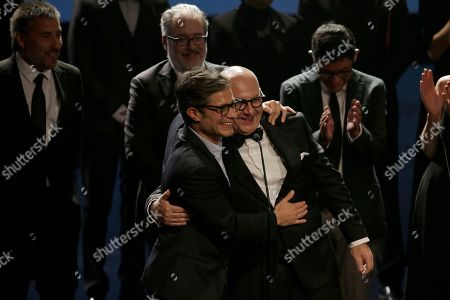 """Stock Photo of Chile's actor Luis Gnecco, right, and Mexican actor Gael Garcia accept the award for best fiction film, for Pablo Larrain's """"Neruda,"""" during the Fenix Ibero American Film Awards at the Esperanza Iris Theater in Mexico City, . Gnecco played the role of Neruda"""