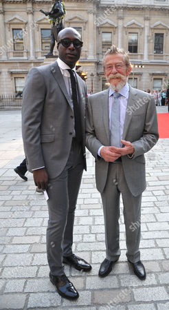 Stock Picture of A Jubilee Celebration of the Arts at the Royal Academy of Arts Piccadilly London Oswald Boateng & John Hurt
