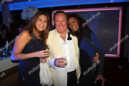 Bell Pottinger Private Screening of Skyfall at the Lounge the Odeon Whiteley's Queensway London Susan Nilsson Andrew Neil & Phoebe Vela