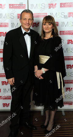 Stock Photo of Christmas Carols with the Stars in Aid of Leukaemia Research at the Royal Albert Hall Kensington Gore London Ray Macallan (honest the Bill Holby City) & Sarah Anthony