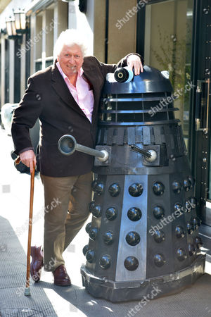 The 4th Dr Who Tom Baker Meets Lone of His Old Enemies A Dalek When He Arrived at the Ivy Club West Street Convent Garden London For A Launch of the New Doctor Who Series Starting On the Horror Channel On Good Friday