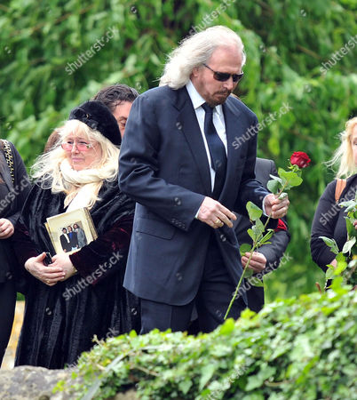 Stock Picture of Funeral of Robin Gibb at St Marys Church Thame Oxfordshire Barry Gibb & Dwina Murphy Gibb