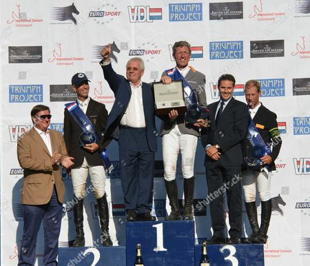 Stock Picture of Global Champions Tour International Concours Valkenswaard Saturday Gct Grand Prix of Valkenswaard the Prize Giving the Winner Ludger Beerbaum On Chaman ( C 2nd Richard Spooner ( L ) and 3rd Rolf-göran Bengtsson