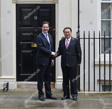 The Rt Hon George Osborne Mp Chancellor of the Exchequer Greets Li Changchun of the Chinese Communist Party As He Arrives at Number 11 Downing Street Before His Meeting with Prime Minister David Cameron