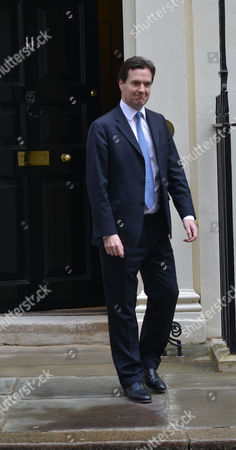 The Rt Hon George Osborne Mp Chancellor of the Exchequer Waits to Greet Li Changchun of the Chinese Communist Party As He Arrives at Number 11 Downing Street Before His Meeting with Prime Minister David Cameron