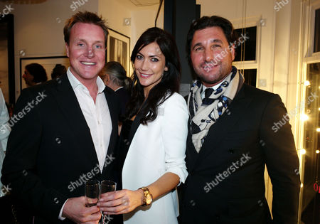 Stock Photo of Private View of Marco Glaviano: Supermodels at the Little Black Gallery Park Walk Fulham London Henry Bethwith & Louise Cole & Georgio Veroni