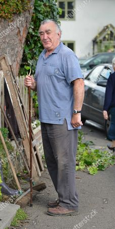 Stock Picture of Michael Mates Taking A Stroll Though Compton From His Neighbouring Village of West Marden