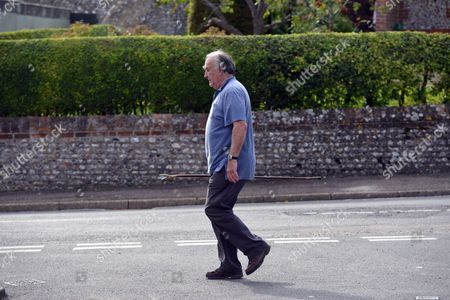 Stock Image of Michael Mates Taking A Stroll Though Compton From His Neighbouring Village of West Marden