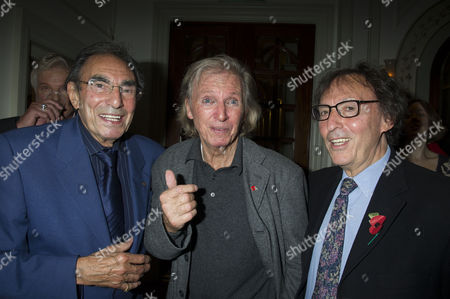 Stock Photo of Press Night For Scrooge at the London Palladium Argyll Street Soho London the After Party Tommy Steele Witjh Don Black ( Oscar Winning Song Writer) ( R ) and His Brother Michael Black (l )