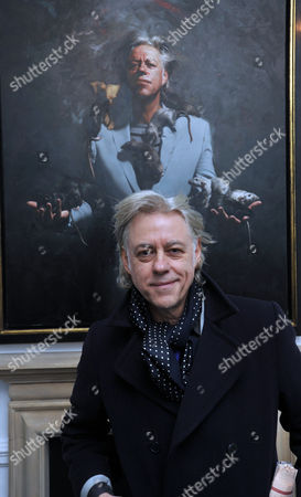 Private View at the Halcyon Gallery in New Bond Street Mayfair London Bob Geldof with His Portrait by Artist Mitch Griffiths
