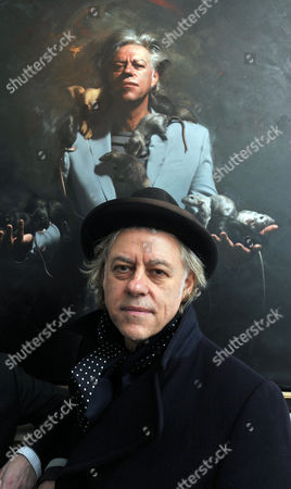 Stock Photo of Private View at the Halcyon Gallery in New Bond Street Mayfair London Bob Geldof with His Portrait by Artist Mitch Griffiths