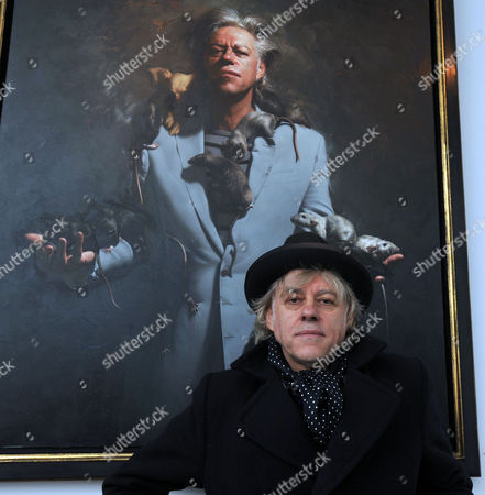 Stock Image of Private View at the Halcyon Gallery in New Bond Street Mayfair London Bob Geldof with His Portrait by Artist Mitch Griffiths