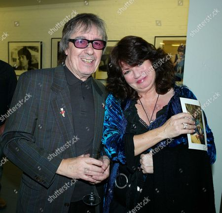 Stock Image of Private View of Second Nature A Photographic Exhibition by Bill Wyman at Kenny Schachter Rove Lincoln House Hoxton Square London Bill Wyman with Ruth Burnett (kermit)