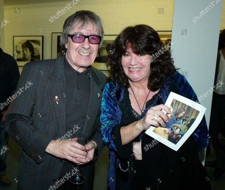 Private View of Second Nature A Photographic Exhibition by Bill Wyman at Kenny Schachter Rove Lincoln House Hoxton Square London Bill Wyman with Ruth Burnett (kermit)