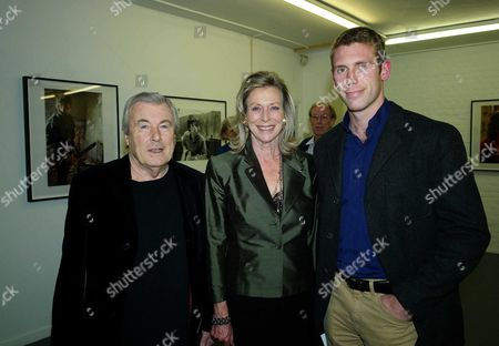 Private View of Second Nature A Photographic Exhibition by Bill Wyman at Kenny Schachter Rove Lincoln House Hoxton Square London Terry O'neill with His Wife Lorraine Ashton and Son Claude