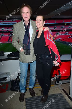 London UK 23rd May 2016: Ray Davies and Alma K at the Bobby World Premiere Held at Wembley Football Stadium, the First Time a Film has Ever Premiered at the Stadium On the 23rd May 2016.