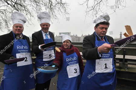 Shrove Tuesday Charity Pancake Race with Mps and Lords Joined by Media in A Race to the Finish in Aid of Rehab Lord Kennedy Lord St John Baroness Kramer & Lord Addington