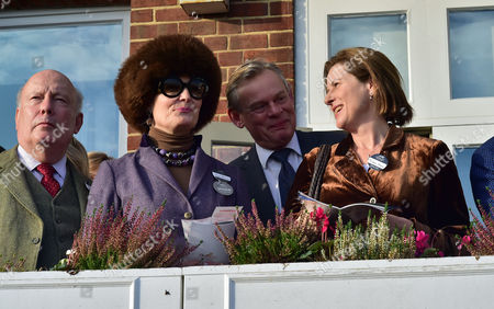 The 58th Hennessy Gold Cup at Newbury Racecourse Berkshire Lord Julian & Lady Emma Fellowes with Martin Clunes and His Wife Philippa Braithwaite