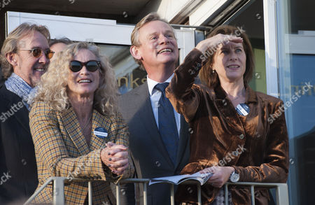The 58th Hennessy Gold Cup at Newbury Racecourse Berkshire Mike Rutherford Angie Rutherford Martin Clunes and His Wife Phillipa Brithwaite