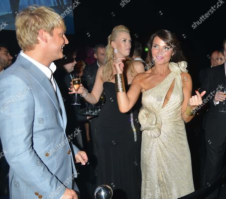 Stock Image of The F1™ Party in Aid of Great Ormond Street Hospital Children's Charity at Battersea Evolution Chelsea Bridge Entrance Battersea Park London Gary Turner Nikki Zilli & Lizzie Cundy