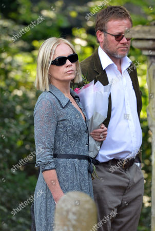 Stock Picture of The Funeral of Peaches Geldof at St Mary Magdalene and St Lawrence Church in Davington Near Faversham Kent Mariella Frostrup with Her Husband Jason Mccue