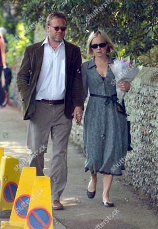 Stock Image of The Funeral of Peaches Geldof at St Mary Magdalene and St Lawrence Church in Davington Near Faversham Kent Mariella Frostrup with Her Husband Jason Mccue