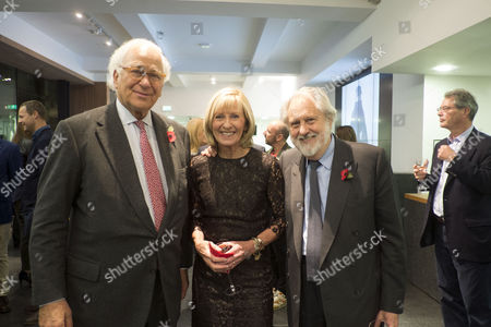Stock Image of The Launch of Terence Donovan Fashion at the Photographers Gallery Ramillies Street London Sir Evelyn De Rothschild with Lord David and Lady Patsy Puttnam