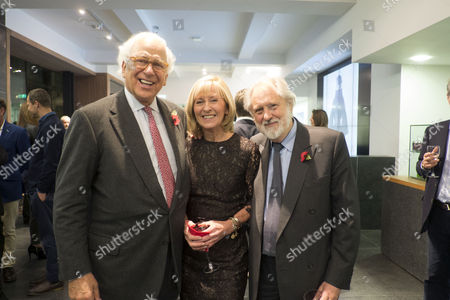 Stock Photo of The Launch of Terence Donovan Fashion at the Photographers Gallery Ramillies Street London Sir Evelyn De Rothschild with Lord David and Lady Patsy Puttnam