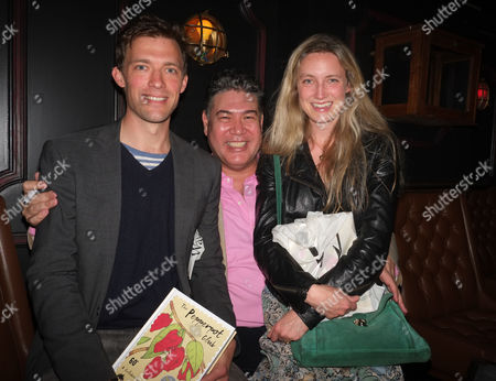 Stock Picture of The Pepperpot Club Book Launch at the Rum Kitchen All Saints Road Notting Hill West London the Books Author Jonathan Phang with Donald & Eva Rice