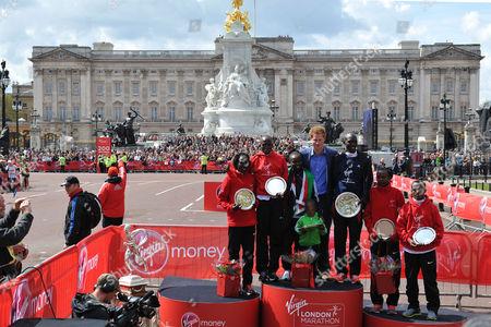 The Virgin London Marathon Finish On the Mall Westminster London Prince Harry Poses with the London Marathon Winners (l-r) Edna Kiplagat of Kenya Martin Lel of Kenya Mary Keitany of Kenya Wilson Kipsang of Kenya Priscah Jeptoo of Kenya and Adil Annani of Morocco