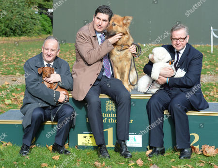 Westminster Dog of the Year Victoria Tower Gardens London 3rd Place Laurance Robertson Mp with Sausage This Years Winner and Rob Flello Mp with Diesel and Michael Gove Mp with Scarlet Who Came 2nd