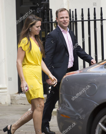 Stock Image of Craig Oliver and David Cameron's Press Secretary Susie Squire Arrive For the National Security Meeting at Number 10 Downing Street
