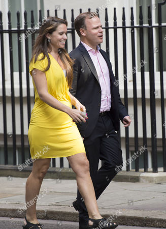 Stock Picture of Craig Oliver and David Cameron's Press Secretary Susie Squire Arrive For the National Security Meeting at Number 10 Downing Street
