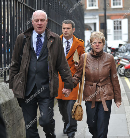 Arrivals at the Leveson Inquiry Into Culture Practices and Ethics of the Press at the High Court London Bob Dowler His Wife Sally Dowler & Mark Lewis(back Orange Coat)