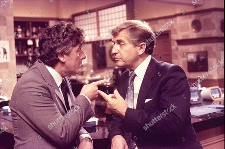 Christopher Coll (as Victor Pendlebury) and Peter Baldwin (as Derek Wilton)